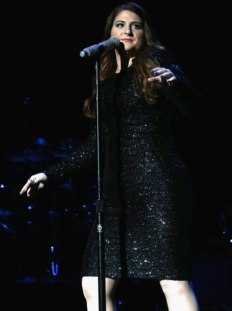 Meghan Trainor sparkles in shimmery black dress at