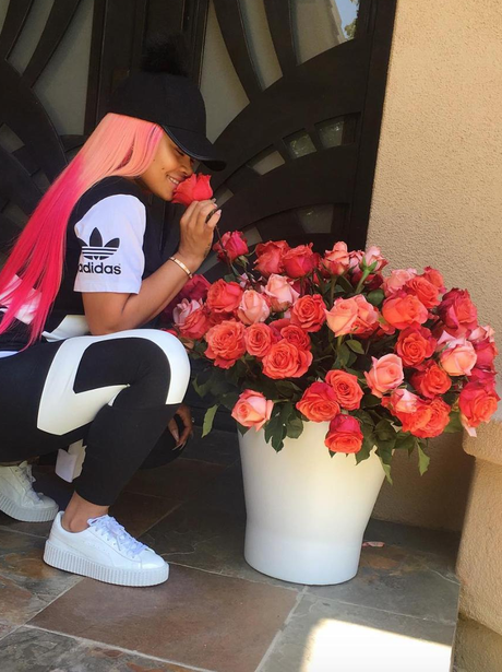 Blac Chyna smells the roses