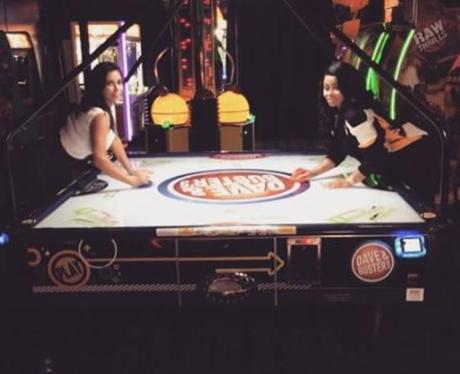 Kim Kardashian and Blac Chyna play air hockey at K