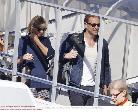 Taylor Swift and Tom Hiddleston land in Australia
