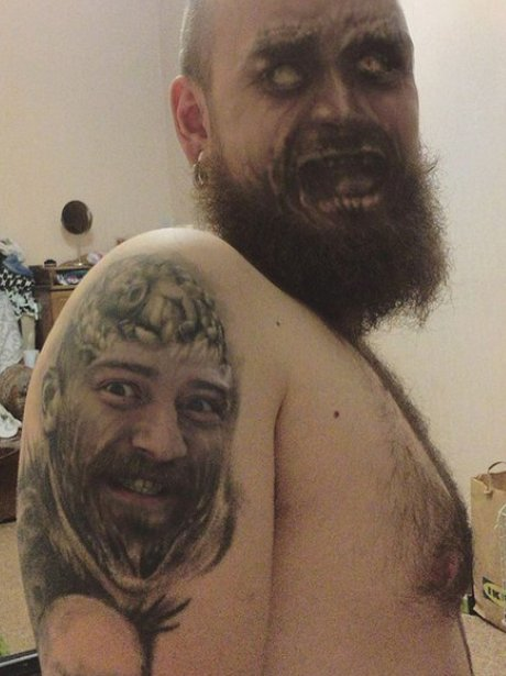 Guy does a face swap with his tattoo and it's terr