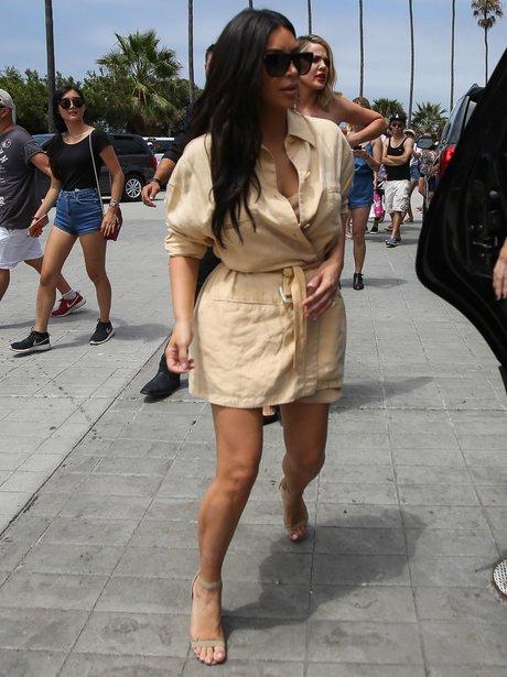 Kim Kardashian sports short dress as she heads to