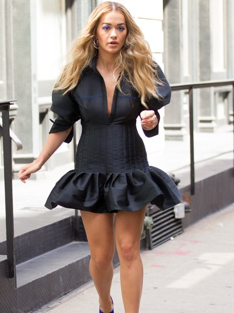 Rita Ora sports frilled dress and high heels in Ne