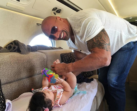 The Rock changes a nappy on board private jet
