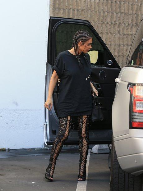 Kim Kardashian in thigh high boots and boxer plait