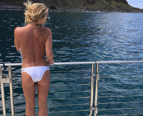 Britney Spears poses topless on luxury yacht