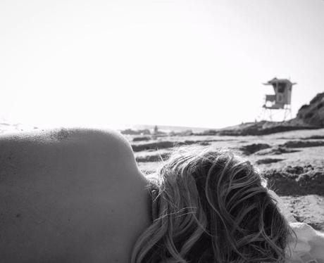 Chloe Grace Moretz goes topless on the beach