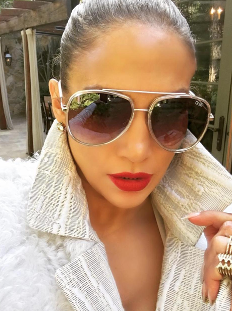 J.Lo shows off her best pout in red lipstick