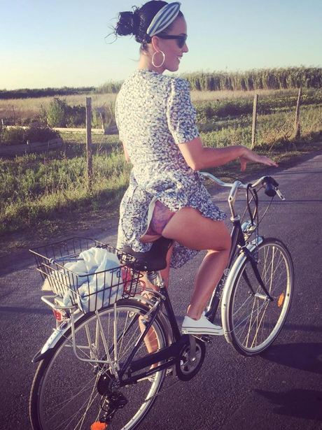 Katy Perry goes for a cheeky bike ride