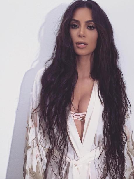 Kim Kardashian shoes off long locks