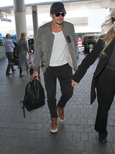 Orlando Bloom catches a flight out of LA amidst ru