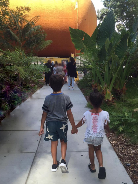 North West and Mason hold hands