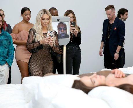 Kim Kardashian facetimes Kanye West during exhibit