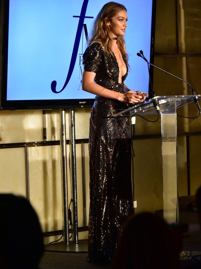 Gigi Hadid accepts her award during the FIJI Water