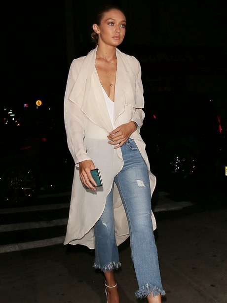 Gigi Hadid sports low cut bodysuit and jeans