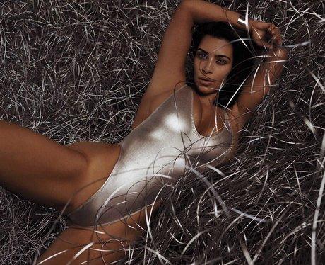 Kim Kardashian poses in metallic swimsuit