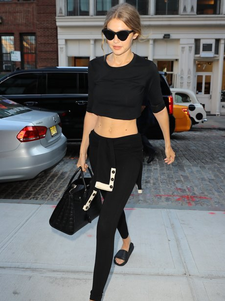 Gigi Hadid shows off her toned abs as she heads ho