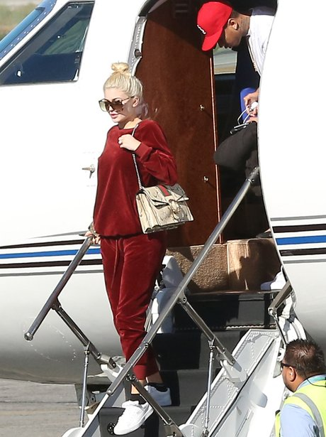 Kylie Jenner and Tyga leave private jet