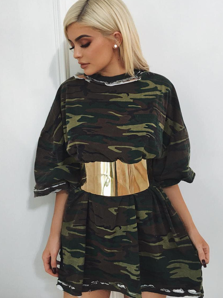 Kylie Jenner in camo top and belt