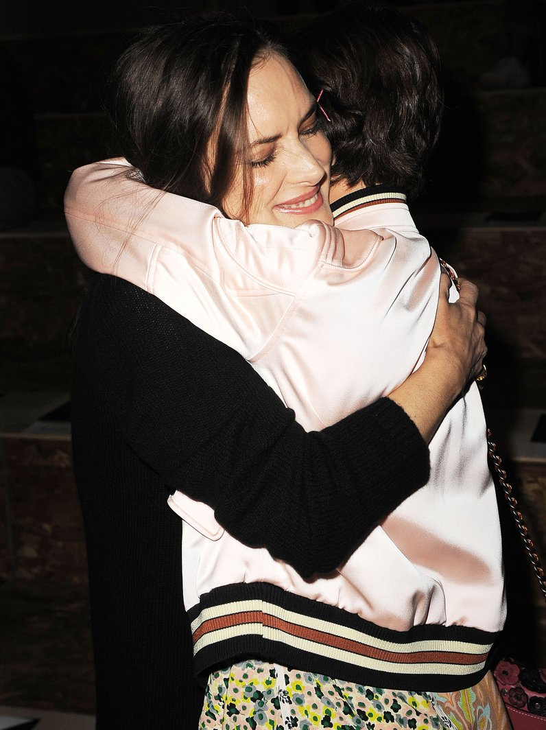 Millie Bobby Brown hugs co-star Winona Ryder at Co