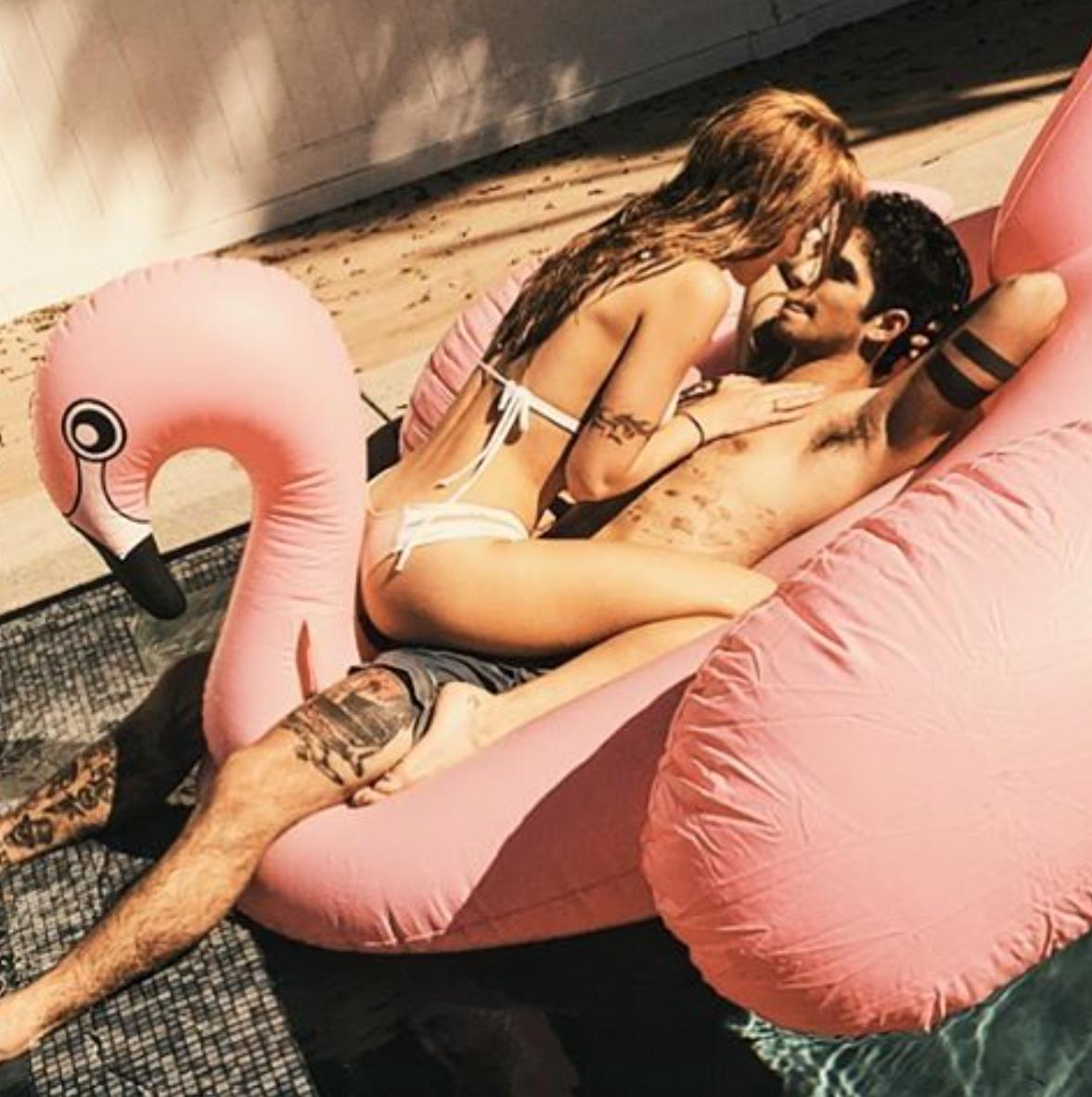 Bella Thorne and Tyler Posey pose in the pool