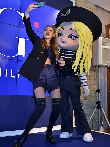 Gigi Hadid poses with cartoon version of herself