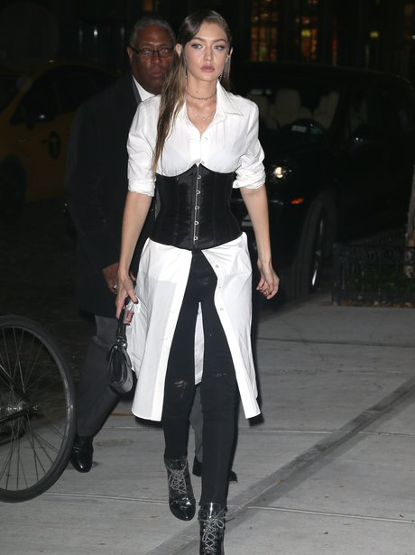Gigi Hadid wears her corset OVER a shirt as she at