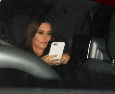 Cheryl caught texting as she lives TV appearance