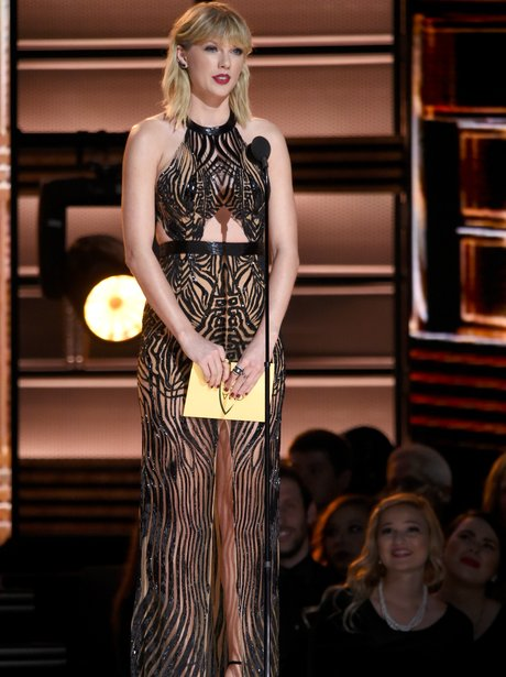 Taylor Swift presents an award at the CMAs
