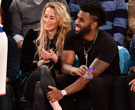 Jason Derulo cosies up to backing dancer Rogan Mil