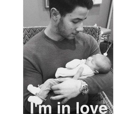 Nick Jonas meets his new niece, Valentina