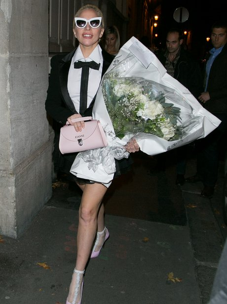 Lady Gaga heads out with monogrammed handbag