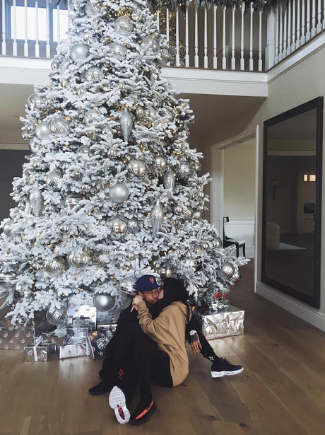 Kylie Jenner and Tyga cuddle up under the Christma
