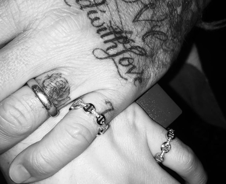 David Beckham and Brooklyn show off matching rings