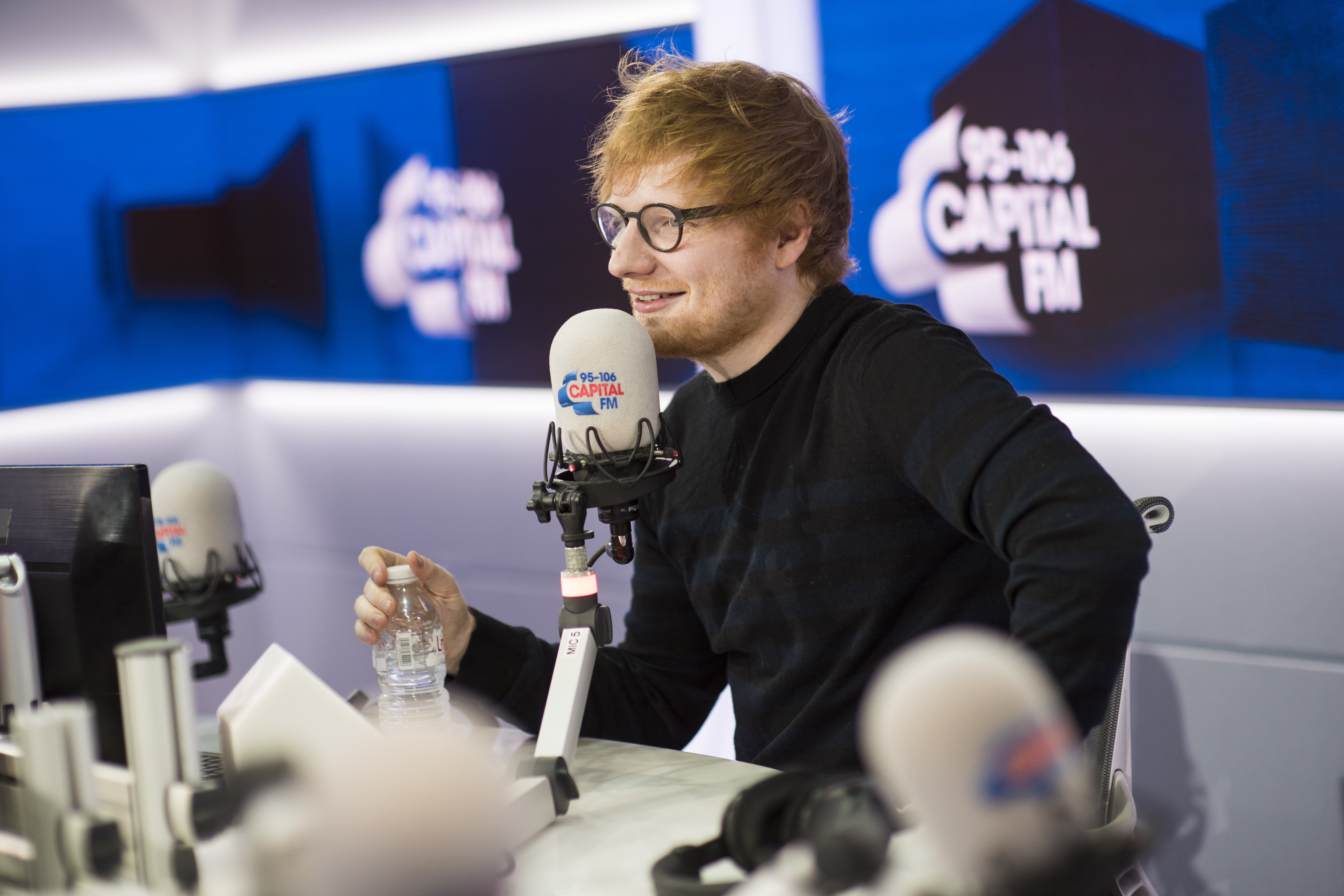Ed Sheeran tattoos Roman Kemp live on air