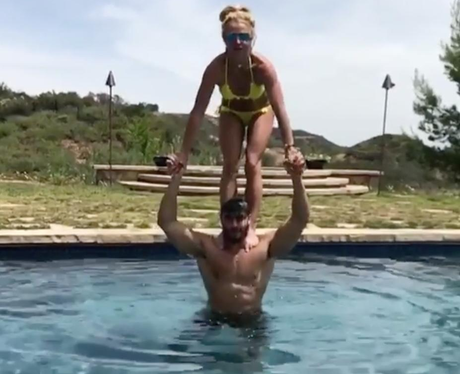 Britney Spears plays around with her boyfriend in