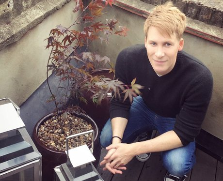 Dustin Lance Black plants tree with Tom Daley to m