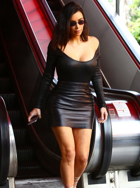 Kim Kardashian shows off her curves in a leather s