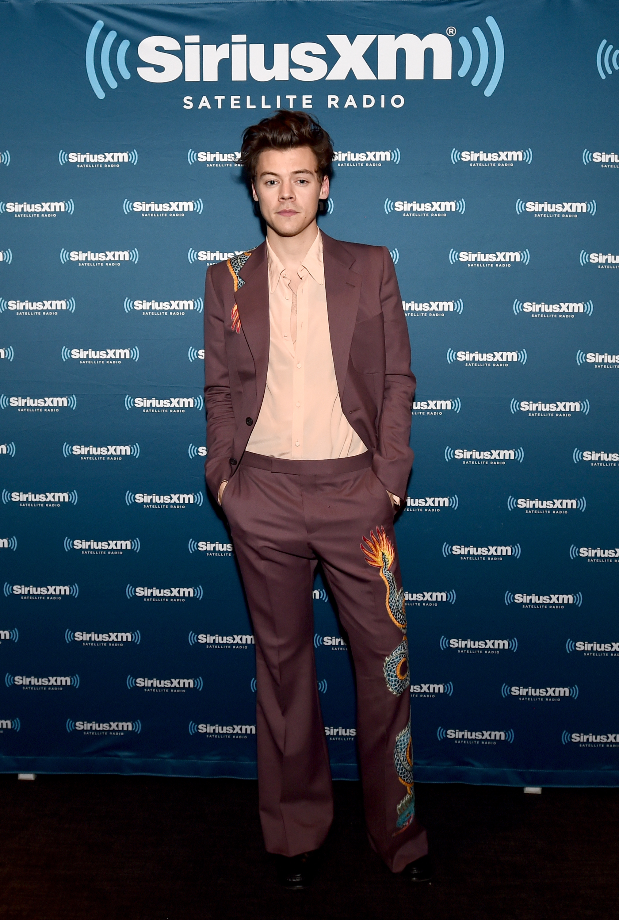 Harry Styles in bold flared trouser suit