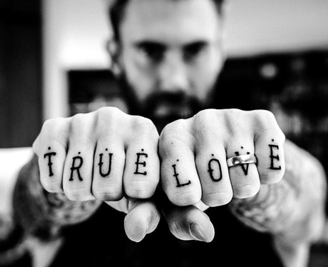 Adam Levine shows off his new tattoo