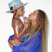Image 6: Beyonce balances Blue Ivy on her baby bump
