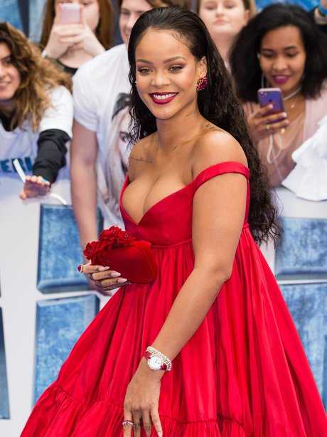 Rihanna opts for a busty dress as she attends the