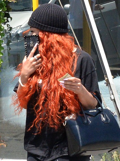 Blac Chyna hides her lips with her phone
