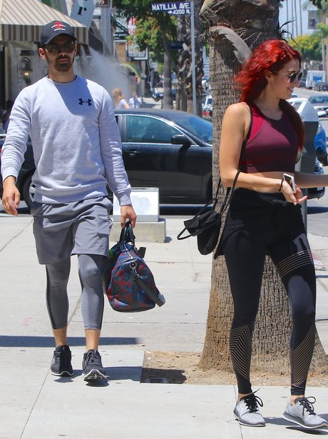 Joe Jonas out for lunch with mystery redhead and b