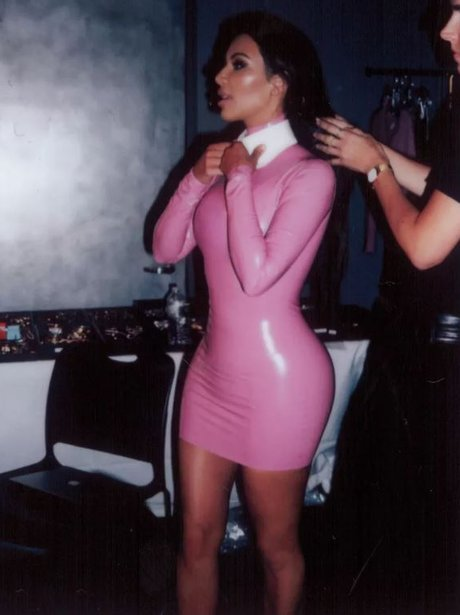 Kim Kardashian sports a latex dress in BTS photos