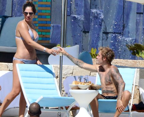 Justin Bieber raises a glass with mysterious lady