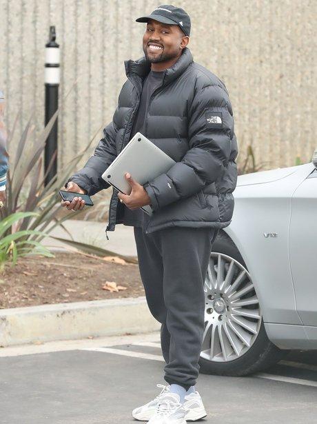 Kanye West beaming