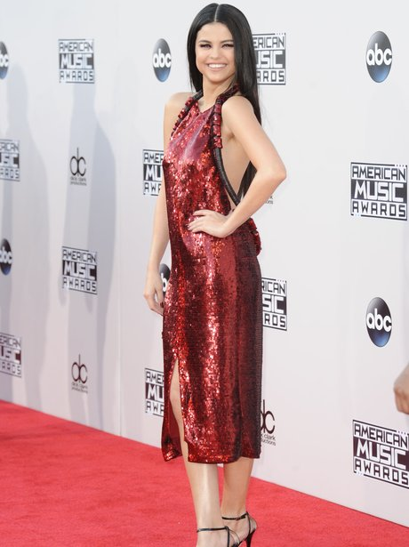 f765f9c89e4 Selena Gomez gave us some serious glam with this sparkly red backless dress  at the 2015 AMAs