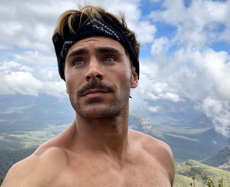Zac Efron topless up a mountain