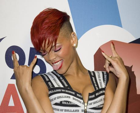 Rihanna with short red hair